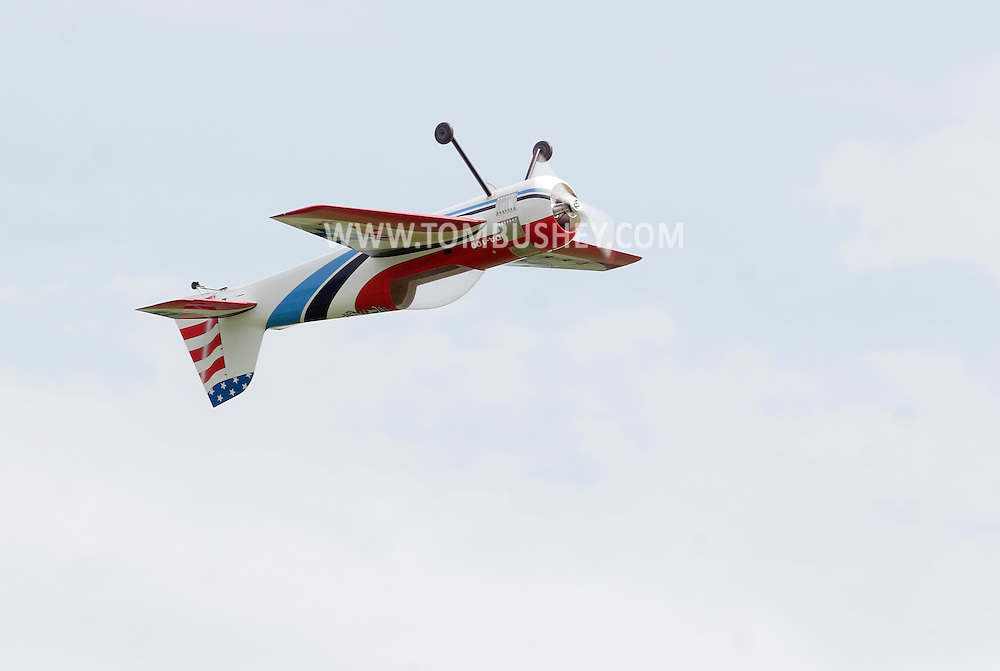 New Hampton, New York - A remote controlled airplane flies upside down at a fly-in sponsored by the Wawayanda Flying Club on June 5, 2010.