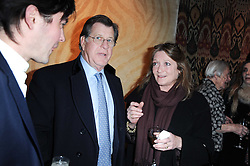 SIMON ELLIOT and LEONORA, COUNTESS OF LICHFIELD at the opening of Luke Irwin's showroom at 22 Pimlico Road, London SW1 on 24th November 2010.