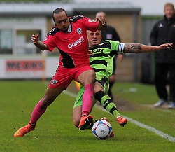 Forest Green Rovers's David Pipe battles for the ball against Dover Athletic's Ricky Modeste.  - Photo mandatory by-line: Nizaam Jones - Mobile: 07966 386802 - 25/04/2015 - SPORT - Football - Nailsworth - The New Lawn - Forest Green Rovers v Dover - Vanarama Conference League