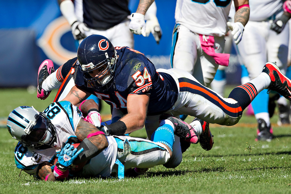 CHICAGO, IL - OCTOBER 2:   Steve Smith #89 of the Carolina Panthers is tackled from behind by Brian Urlacher #54 of the Chicago Bears at Soldier Field on October 2, 2011 in Chicago, Illinois.  The Bears defeated the Panthers 34 to 29.  (Photo by Wesley Hitt/Getty Images) *** Local Caption *** Steve Smith; Brian Urlacher