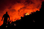 Feeling the heat of the flowing lava in the erupting volcano Fimmvörðuháls, south Iceland