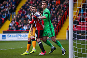 Bradford City forward Alex Jones (19) is well looked after by Sheffield United defender, on loan from Burnley, Danny Lafferty (24)  during the EFL Sky Bet League 1 match between Sheffield Utd and Bradford City at Bramall Lane, Sheffield, England on 17 April 2017. Photo by Simon Davies.