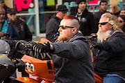 A biker with a mohawk haircut cruises down Main Street during the 74th Annual Daytona Bike Week March 7, 2015 in Daytona Beach, Florida.