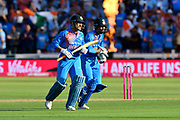 Batsmen MS Dhoni of India and Hardik Pandya of India run off the field after helping India post 148 runs in their 20 overs during the International T20 match between England and India at the SWALEC Stadium, Cardiff, United Kingdom on 6 July 2018. Picture by Graham Hunt.
