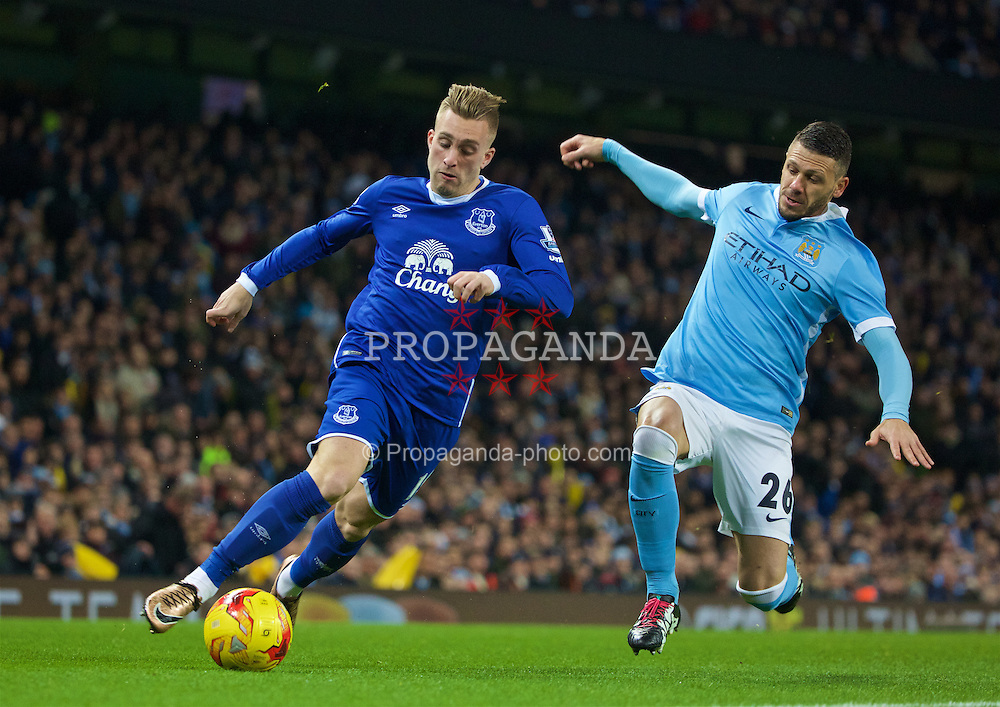 MANCHESTER, ENGLAND - Wednesday, January 27, 2016: Everton's Gerard Deulofeu in action against Manchester City's Martin Demichelis during the Football League Cup Semi-Final 2nd Leg match at the City of Manchester Stadium. (Pic by David Rawcliffe/Propaganda)