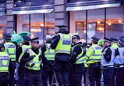 Pictured: Into the evening there was still a hard core of protesters, heavily outnumbered by police, who refused to move. At 8.15pm a senior police officer issued an order to disperse, and the protesters were then allowed to leave in pairs. <br /> <br /> Extinction Rebellion Scotland hosted a demo in which protestors were encouraged to block traffic on North Bridge, Edinburgh, in a bid to highlight the climate change issue, as part of a co-ordinated nationwide action.<br /> <br /> © Dave Johnston/ EEm