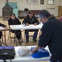 From left, Anne Silversmith, Karen Nez, Ray Shabi and Patty Begay listen to the instructions of Dave Sangster on proper CPR technique December 20 in Greasewood Springs.