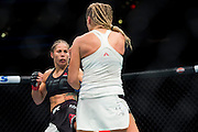 Liz Carmouche throws a kick against Katlyn Chookagian during UFC 205 at Madison Square Garden in New York, New York on November 12, 2016.  (Cooper Neill for The Players Tribune)