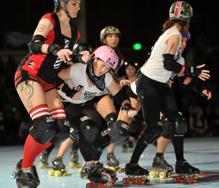 The Cherry City Derby Girls' 8 Wheel Assassins visit the Emerald City Roller Girls' Church of Sk8in in Eugene on April 23, 2011.  (photo by Casey Campbell)