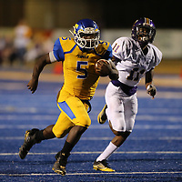 Tupelo running back Jaquerrious Williams races past Columbus defender Jordan Randle for a 48 yard touchdown run in the second quarter.