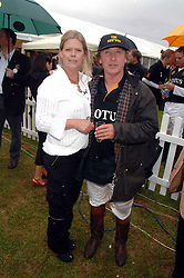 KENNEY JONES and his wife JAYNE owners of Hurtwood Polo Club at the Kuoni World Clas Polo Cup in aid of Breast Cancer Care held at Hurtwood Park Polo Club, Ewhurst, Surrey on 27th May 2007.<br /><br />NON EXCLUSIVE - WORLD RIGHTS