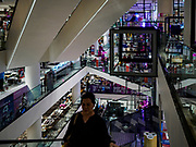 17 DECEMBER 2018 - BANGKOK, THAILAND: Shoppers on an escalator in Siam Discovery, an upscale mall in central Bangkok. According to Credit Suisse Global Wealth Databook 2018, which surveyed 40 countries, Thailand has the highest rate of income inequality in the world. In 2016, Thailand was third, behind Russia and India. In 2016, the 1% richest Thais (about 500,000 people) owned 58.0% of the Thailand's wealth. In 2018, they controlled 66.9%. In Russia, those numbers went from 78% in 2016, down to 57.1% in 2018. The Thai government disagreed with the report and said the report didn't take government anti-poverty programs into account and that Thailand was held to an unfair standard because most of the other countries in the report are developed countries in the Organisation for Economic Co-operation and Development.     PHOTO BY JACK KURTZ