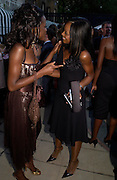 June Sarpong and Phoebe Vela. The Business Summer party hosted by Andrew Neil. Italian Hotel, Ritz Hotel. 12 July 2005. ONE TIME USE ONLY - DO NOT ARCHIVE  © Copyright Photograph by Dafydd Jones 66 Stockwell Park Rd. London SW9 0DA Tel 020 7733 0108 www.dafjones.com