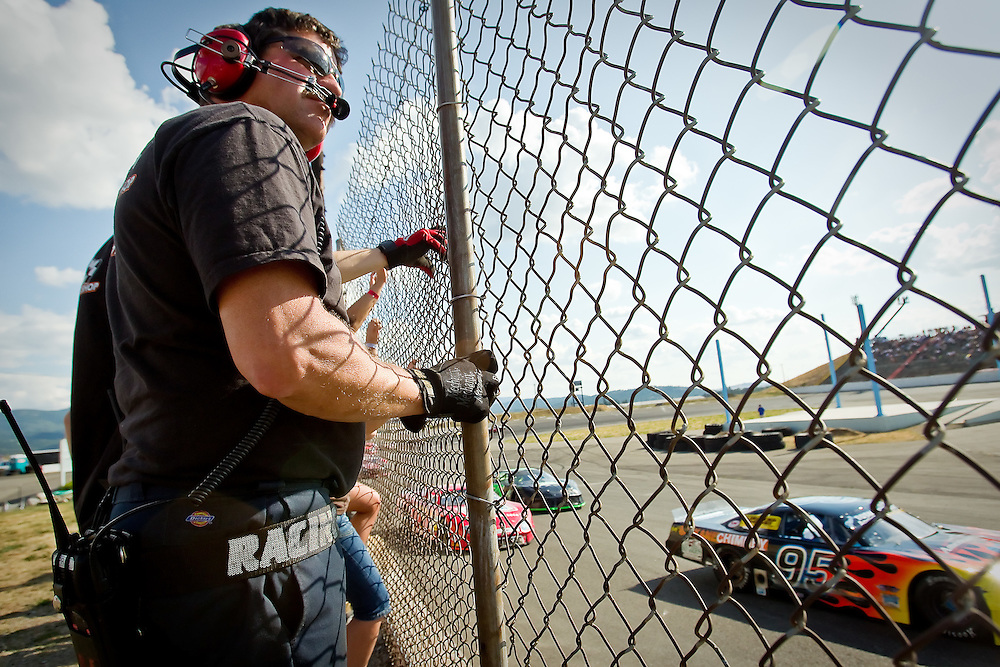 Mark Jenkins, a crew member with Gary Lewis Motorsports' team, watches his car make its way around the track during the opening 100 laps of the Idaho 200.
