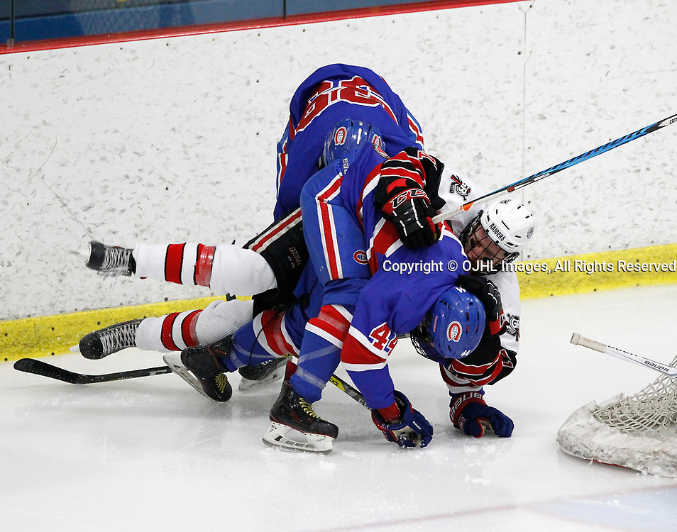 GEORGETOWN, ON  - MAR 18,  2017: Ontario Junior Hockey League, playoff game between the Georgetown Raiders and the Toronto Junior Canadiens. Chris Giroday #44 and Anthony Romano #39 of the Toronto Jr. Canadiens battle for position with Jonathan Hampton #71 of the Georgetown Raiders during the second period.<br /> (Photo by Tim Bates / OJHL Images)