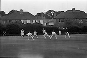 18/07/1970<br /> 07/18/1970<br /> 18 July 1970<br /> Cricket: Clontarf 1st XI v Old Belvedere, Leinster Senior Cup Final at Clontarf Cricket Club, Castle Avenue, Dublin. Clontarf players alert as Frank O'Hanlon (centre), Old Belvedere opening batsman hits a high ball that nobody caught.