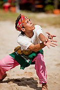 "Sept. 27, 2009 -- PATTANI, THAILAND: A Muslim man performs a traditional Pattani folk dance from the time of the Pattani Sultanate in the 1600's at a community festival in Pattani, Thailand.  Thailand's three southern most provinces; Yala, Pattani and Narathiwat are often called ""restive"" and a decades long Muslim insurgency has gained traction recently. Nearly 4,000 people have been killed since 2004. The three southern provinces are under emergency control and there are more than 60,000 Thai military, police and paramilitary militia forces trying to keep the peace battling insurgents who favor car bombs and assassination.   Photo by Jack Kurtz / ZUMA Press"