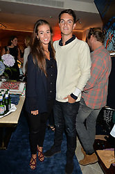 VISCOUNT ERLEIGH and OLIVIA CALLAGHAN at a party to celebrate the launch of Baar & Bass, 336 Kings Road, London on 9th September 2014.