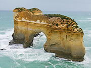 Island Archway as it appeared in 2004 (before its partial collapse in 2009) in Twelve Apostles Marine National Park, seen from a walkway in Port Campbell National Park, Victoria, Australia. The Great Ocean Road (B100) is a 243-km highway along the southeast coast of Australia between Torquay and Warrnambool, in the state of Victoria. Dedicated to casualties of World War I, the Great Ocean Road was built by returned soldiers between 1919 and 1932 and is the world's largest war memorial.
