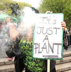 May 4, 2019 - New York, New York, U.S. - Parade goer sokes during the NYC Cannabis Parade and Rally held in Union Square. (Credit Image: © Nancy Kaszerman/ZUMA Wire)