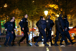 © Licensed to London News Pictures. 15/11/2015. Paris, France. French police rushing to secure Place de La Republique after a false attack alarm in Paris, France following the Paris terror attacks on Sunday, 15 November 2015. Photo credit: Tolga Akmen/LNP