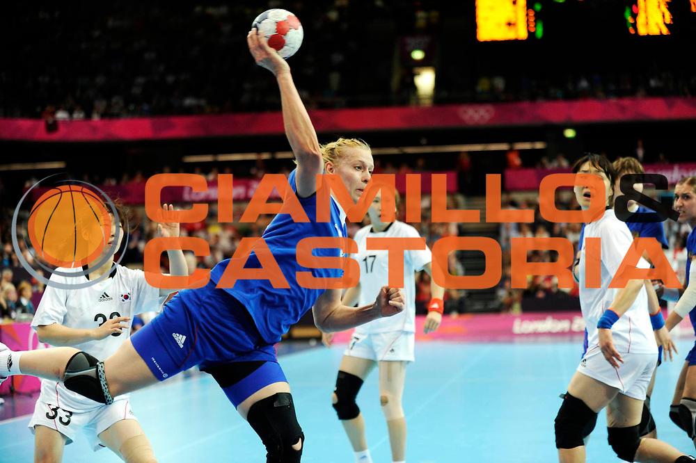 DESCRIZIONE : Handball Jeux Olympiques Londres Quart de Finale<br /> GIOCATORE : Marennikova Ekaterina RUS<br /> SQUADRA : Russie Femme<br /> EVENTO :  Handball Jeux Olympiques<br /> GARA : Coree Russie<br /> DATA : 07 08 2012<br /> CATEGORIA : handball Jeux Olympiques<br /> SPORT : HANDBALL<br /> AUTORE : JF Molliere <br /> Galleria : France JEUX OLYMPIQUES 2012 Action<br /> Fotonotizia : France Handball Femme Jeux Olympiques Londres Quart de Finale Copper Box<br /> Predefinita :