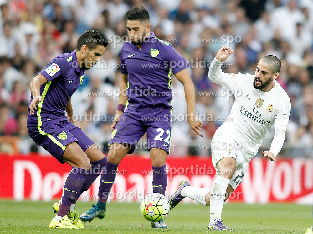 26.09.2015, Estadio Santiago Bernabeu, Madrid, ESP, Primera Division, Real Madrid vs Malaga CF, 6. Runde, im Bild Real Madrid's Isco (r) and Malaga's Jose Luis Garcia Recio (l) and Adnane Tighadouini // during the Spanish Primera Division 6th round match between Real Madrid and Malaga CF at the Estadio Santiago Bernabeu in Madrid, Spain on 2015/09/26. EXPA Pictures &copy; 2015, PhotoCredit: EXPA/ Alterphotos/ Acero<br /> <br /> *****ATTENTION - OUT of ESP, SUI*****