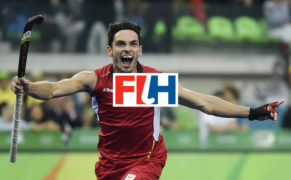 Belgium's Tanguy Cosyns celebrates after scoring the opening goal during the men's Gold medal field hockey Belgium vs Argentina match of the Rio 2016 Olympics Games at the Olympic Hockey Centre in Rio de Janeiro on August 18, 2016. / AFP / PHILIPPE LOPEZ        (Photo credit should read PHILIPPE LOPEZ/AFP/Getty Images)