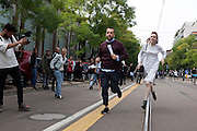 Couple arrives running at Fendi fashion show during the annual Milan Fashion Week, Milan on September 22, 2016.