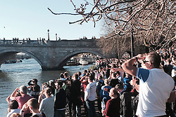 """© Licensed to London News Pictures. 16/03/2014. Richmond, UK. Large crowds gather to watch.  The pleasure cruiser """"The Victoria"""" crashes into Richmond Bridge in surrey today 16th March. There was considerable damage to the vessel. The boat eventually made it through the bridge to cheers from crowds who were enjoying the sunny weather along the River Thames. . Photo credit : Michael Traboulsi/LNP"""