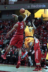22 January 2014:  Reggie Lynch bats at a ball shot by Tekele Cotton during an NCAA Missouri Valley Conference mens basketball game between the Shockers of Wichita Stat and the Illinois State Redbirds  in Redbird Arena, Normal IL.