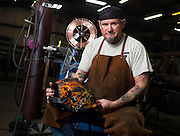 Loren Minnis, 48, sits for a portrait in the Ozarks Barge & Dock Service workshop on April 7, 2014 in Lake of the Ozarks, Mo. Minnis was part owner of Menace Bar & Grill in Lake Elsinore but had to close down in part because of a lawsuit against the bar in 2010. He now works as a welder in Missouri. (David Welker/For the Los Angeles Times)