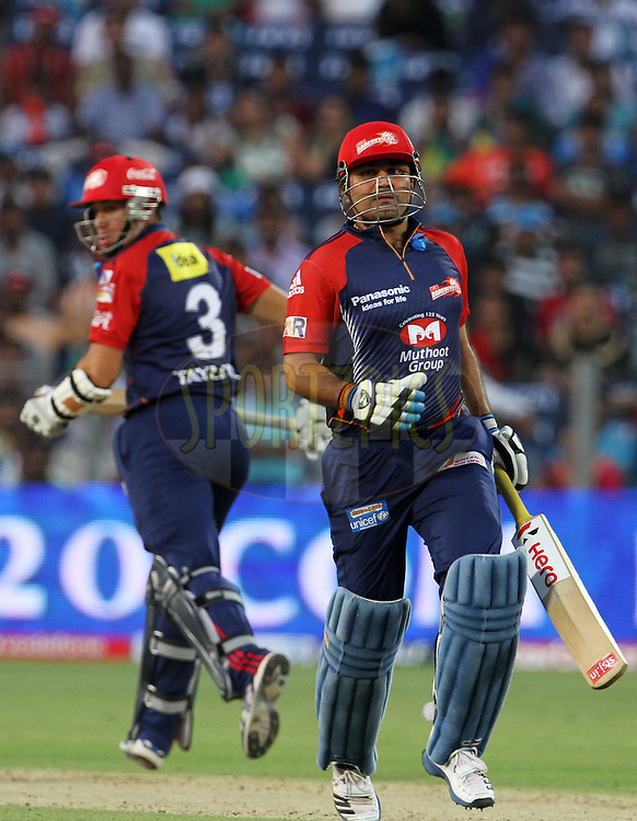 Delhi Daredevils captain Virender Sehwag and Delhi Daredevils player Ross Taylor takes a run during match 31 of the Indian Premier League ( IPL) 2012  between The Pune Warriors India and the Delhi Daredevils held at the Subrata Roy Sahara Stadium, Pune on the 24th April 2012..Photo by Vipin Pawar/IPL/SPORTZPICS