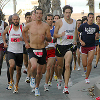 Athletes run during the second annual Saint John's Santa Monica 5000 on Sunday, October 21, 2007.