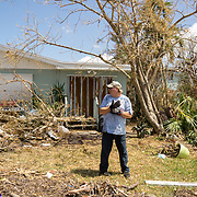 MARATHON, FL - SEPTEMBER 16: <br /> Tim Thompson, Minister of the Marathon Church of Christ, prepares to clear debris in front of the house he rents next to his church after arriving from Homestead where he and his wife evacuated to before Hurricane Irma made landfall. They rent a house next to the church on September 16, 2017 in Marathon, Florida.  (Photo by Angel Valentin/Getty Images)