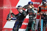 #20 Fabio Quatararo, French: Petronas Yamaha SRT sprays champagne onto winner #12 Maverick Vinales, Spanish: Movistar Yamaha during the Motul Dutch TT MotoGP, TT Circuit, Assen, Netherlands on 30 June 2019.