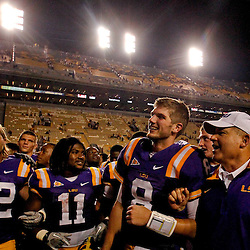 September 10, 2011; Baton Rouge, LA, USA;  LSU Tigers quarterback Zach Mettenberger (8), running back Spencer Ware (11) and head coach Les Miles sing with teammates following a win over the Northwestern State Demons at Tiger Stadium. LSU defeat Northwestern State 49-3. Mandatory Credit: Derick E. Hingle