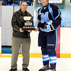 NEWMARKET, ON - Feb 9 : Ontario Junior Hockey League Game Action between the St. Michaels Buzzers and the Newmarket Hurricanes, Ian Edmondson #8 of the St.Michael's Buzzers Hockey Club receives the York Cup in the Battle of York.<br /> (Photo by Brian Watts / OJHL Images)