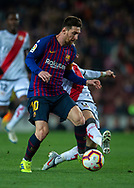 Leo Messi drives the ball pursued by Embarba of Rayo Vallecano (rear)  during the Spanish league football match of 'La Liga'  FC BARCELONA against RAYO VALLECANO at Camp Nou Stadium of Barcelona on March 9,2019