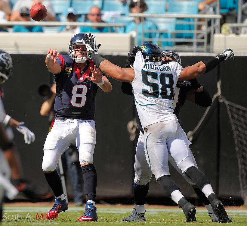 Houston Texans quarterback Matt Schaub (8) is pressured by Jacksonville Jaguars defensive end Aaron Morgan (58) during the Texans 27-7 win at EverBank Field on September 16, 2012 in Jacksonville, Florida. ..©2012 Scott A. Miller..