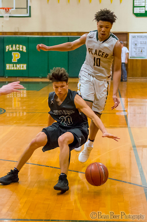 Liberty Ranch Hawks Gabriel Nino (20), looses the ball in front of Placer Hillman Kai Huntsberry (10), during the fourth quarter as the Placer Hillman host the Liberty Ranch Hawks Varsity basketball team in the DIV NorCal boys quarterfinal, Saturday Mar 10, 2018.  <br /> photo by Brian Baer
