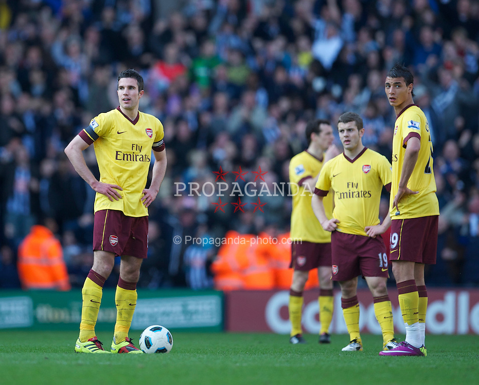 WEST BROMWICH, ENGLAND - Saturday, March 19, 2011: Arsenal's Robin Van Persie and Marouane Chamakh look dejected as West Bromwich Albion score the second goal during the Premiership match at the Hawthorns. (Photo by David Rawcliffe/Propaganda)