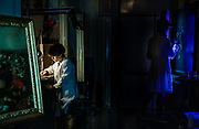 Rome, the coservative studio Merlini Storti, on the left, Barbara Rossodivita working on one of the paintings under restoration; on the right, Chiara Scognamiglio working on a cleaning sample on an 18th-century painting performed under UV-light