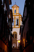 Seville, Spain.<br />Streetlife in Seville. Narrow alleys in the old district of Santa Cruz.
