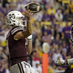Oct 20, 2018; Baton Rouge, LA, USA; LSU Tigers linebacker Devin White (40) hits Mississippi State Bulldogs quarterback Nick Fitzgerald (7) drawing a targeting penalty and ejection during fourth quarter at Tiger Stadium. LSU defeated Mississippi State 19-3. Mandatory Credit: Derick E. Hingle-USA TODAY Sports