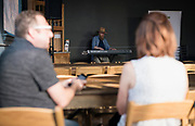 "Composer Patrick Christians plays piano before the live taping of the ""Corner Table Podcast"" at Old Sugar Distillery in Madison, Wisconsin, Tuesday, June 18, 2019."