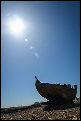 May 6, 2018 - London, London, United Kingdom - Dungeness in Kent...The sun shines on a derelict boat in the Dungeness National Nature Reserve in Kent. (Credit Image: © Pete Maclaine/i-Images via ZUMA Press)