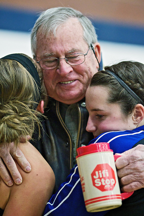 Doug Parker hugs his granddaughters Kylie Parker, left, and Sydni Parker following Coeur d'Alene High's third place win over Highland High in the Idaho 5A state basketball tournament Saturday in Meridian, Idaho.