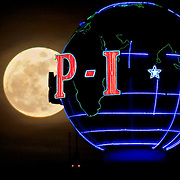 The Seattle Post-Intelligencer's signature neon globe seems to eclipse a full moon on March 10, 2009, a week before the 146 year-old newspaper stopped the presses for the final time.  (Photo by Joshua Trujillo/Seattle Post-Intelligencer)...