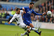 Lee Gregory of Millwall (l) has a shot at goal blocked  by Sean Morrison of Cardiff city &reg;. EFL Skybet championship match, Cardiff city v Millwall at the Cardiff city stadium in Cardiff, South Wales on Saturday 28th October 2017.<br /> pic by Andrew Orchard, Andrew Orchard sports photography.